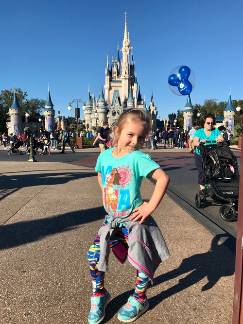 Delaney in front of Disney's Cinderella's Castle