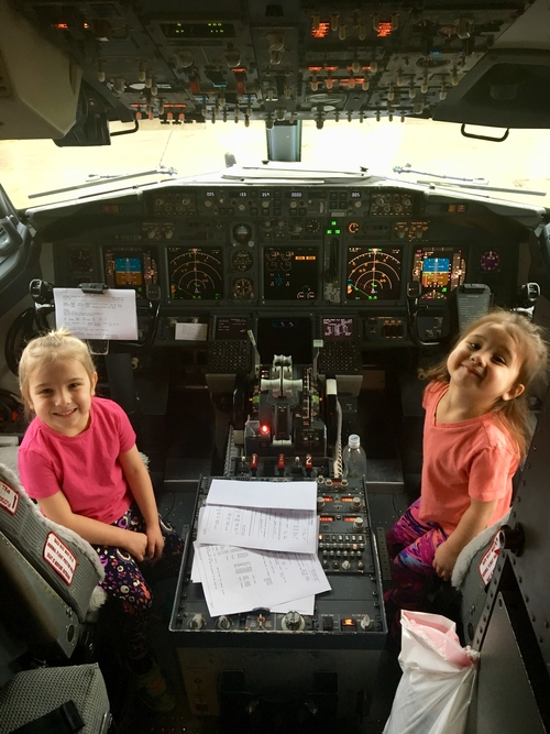 The Littles in airplane cockpit