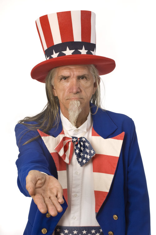 Uncle Sam with his hand out for tax money.