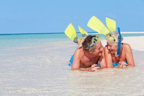 Retired Couple Enjoying A Beach Lifestyle