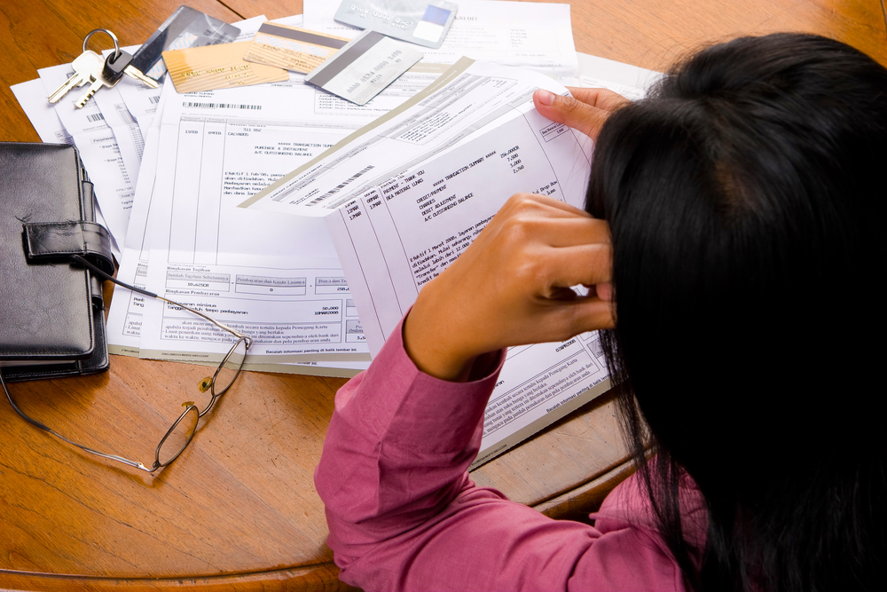 Woman looking at the family's finances