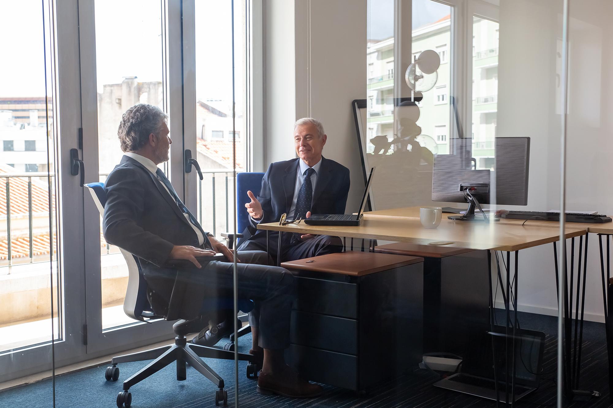 Men sitting in office