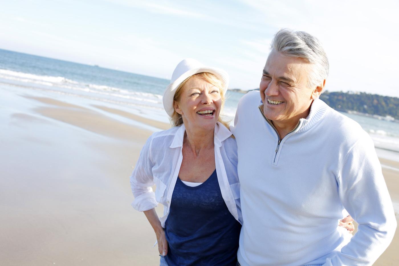 Retirement couple on beach.