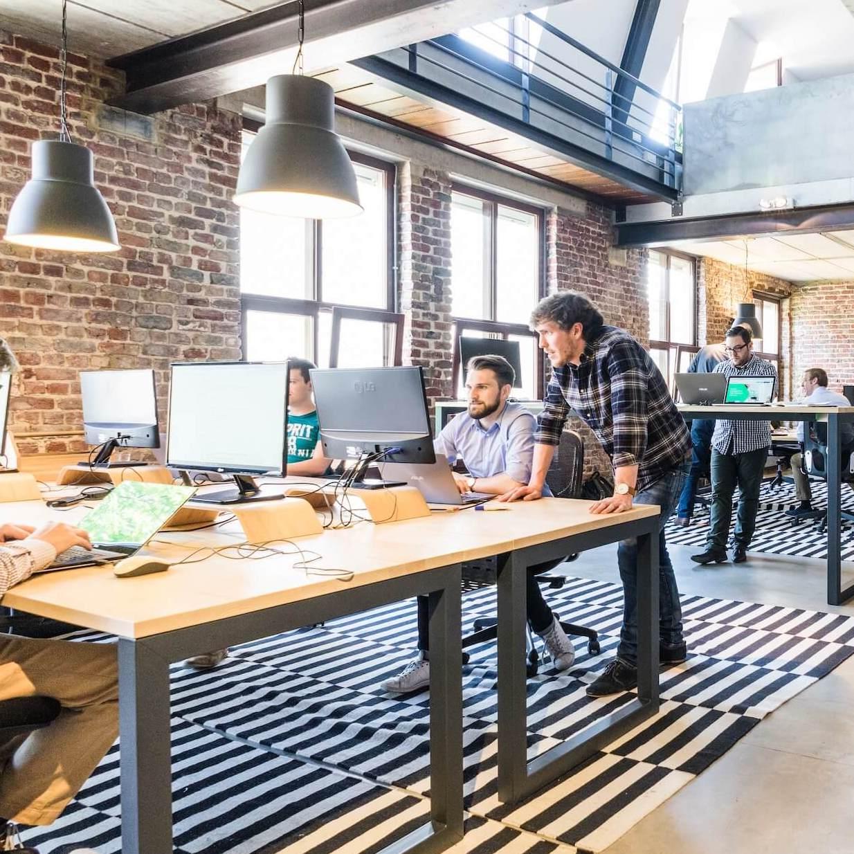 Millenial team working in open office