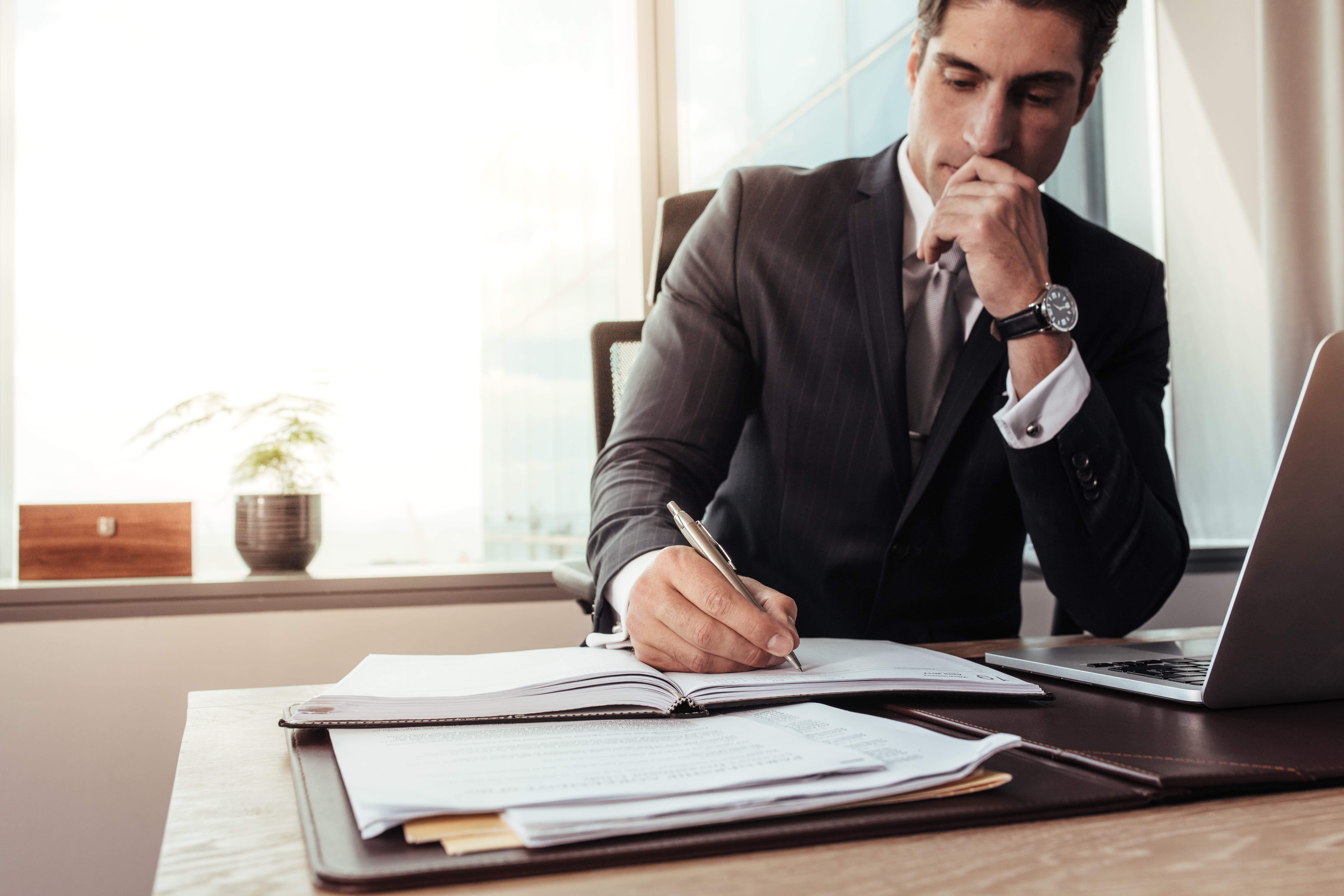 man doing a portfolio double check