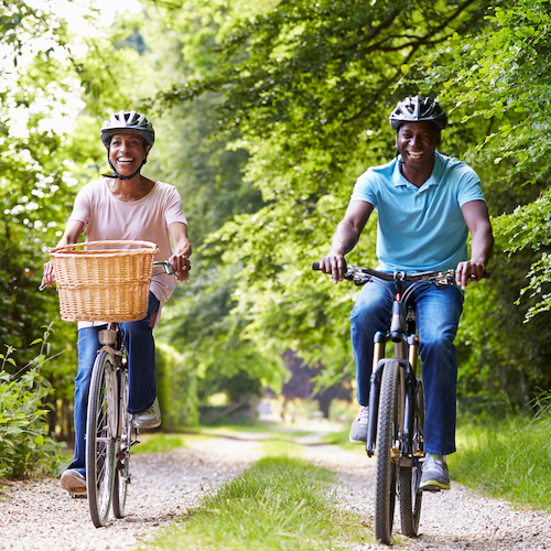 couple riding bike happy, sanders coffee group TRUE private wealth advisors