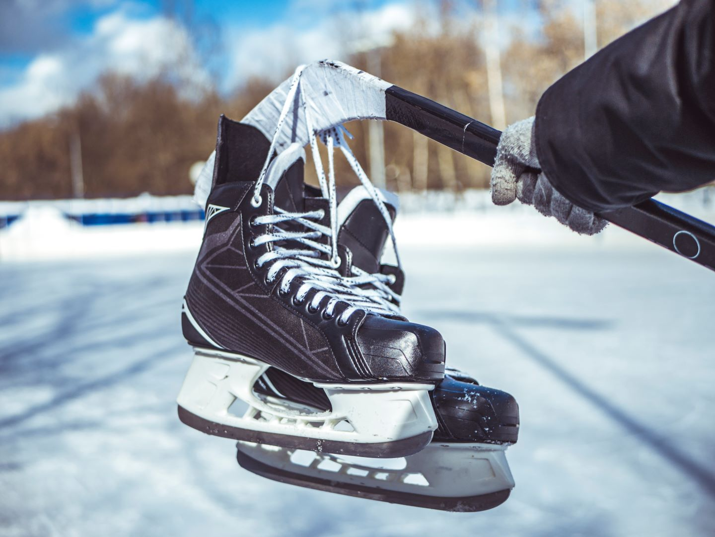 image of hockey stick and ice skates