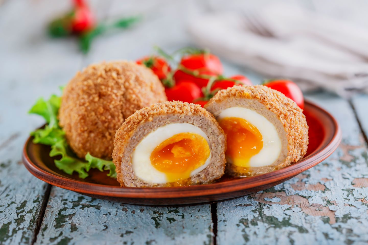 Scotch eggs – made from boiled eggs wrapped in sausage meat and rolled in bread crumbs, then fried to a golden crisp