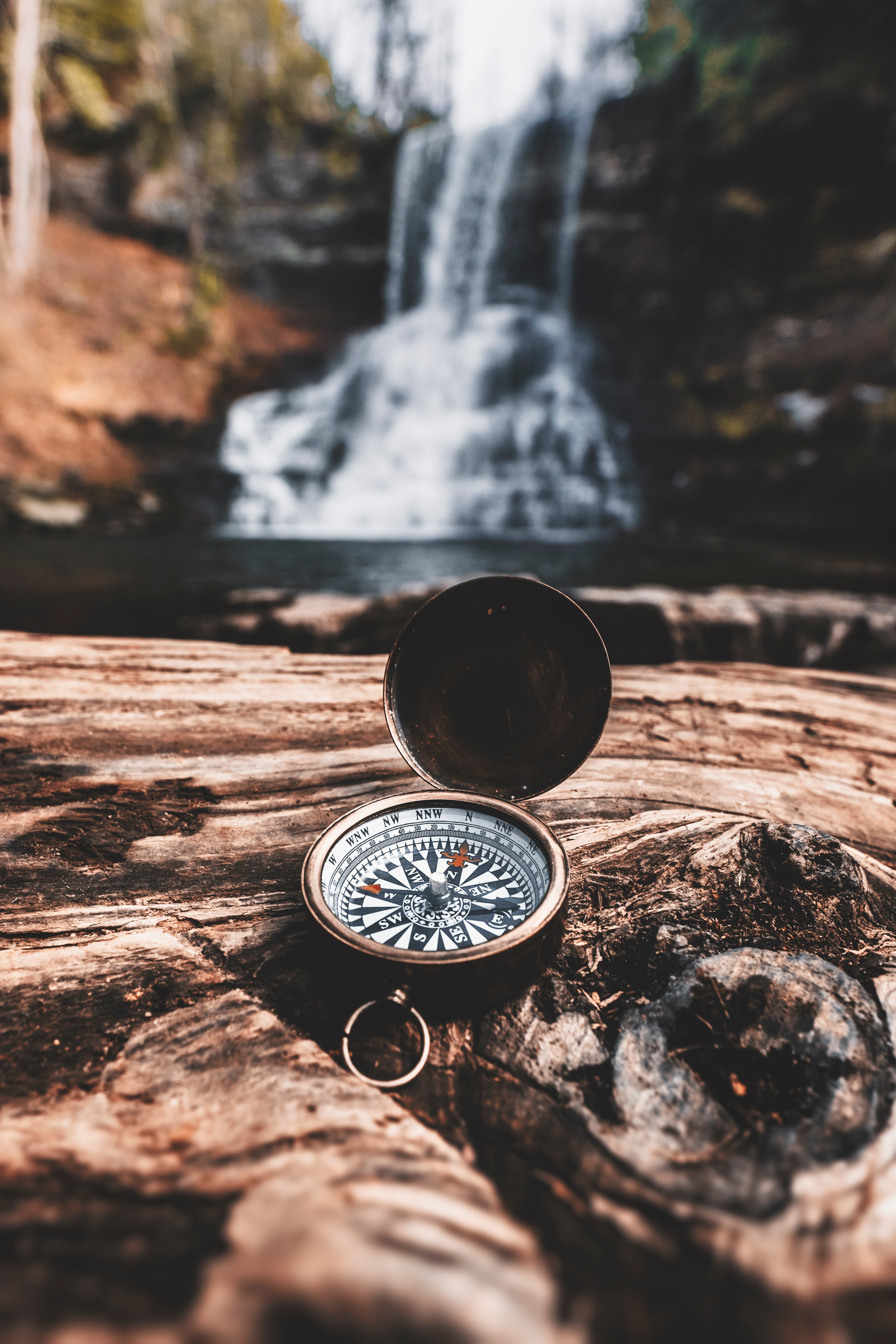 Compass in front of a waterfall - Photo by Bryan Minear on Unsplash