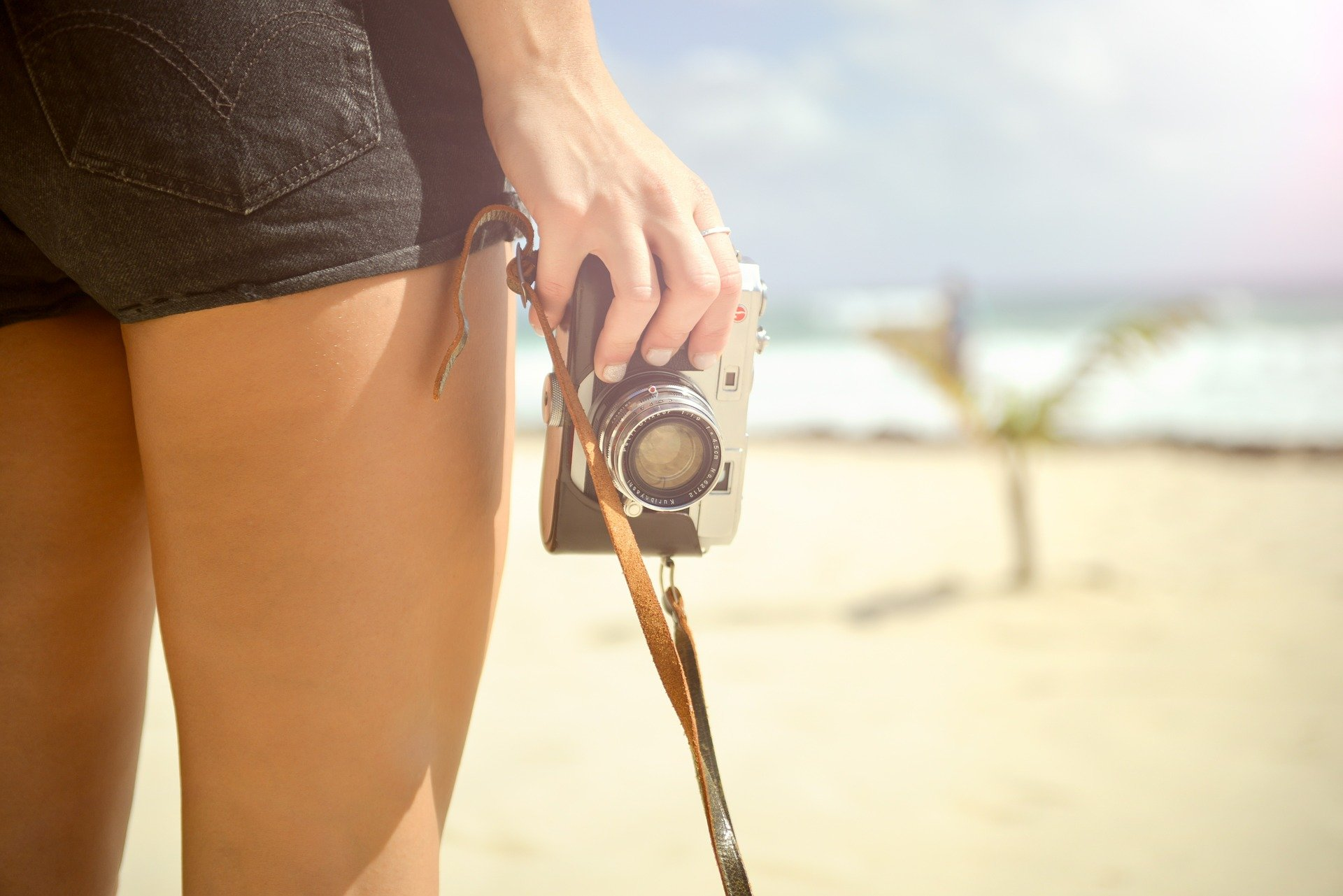 image of woman holding a camera