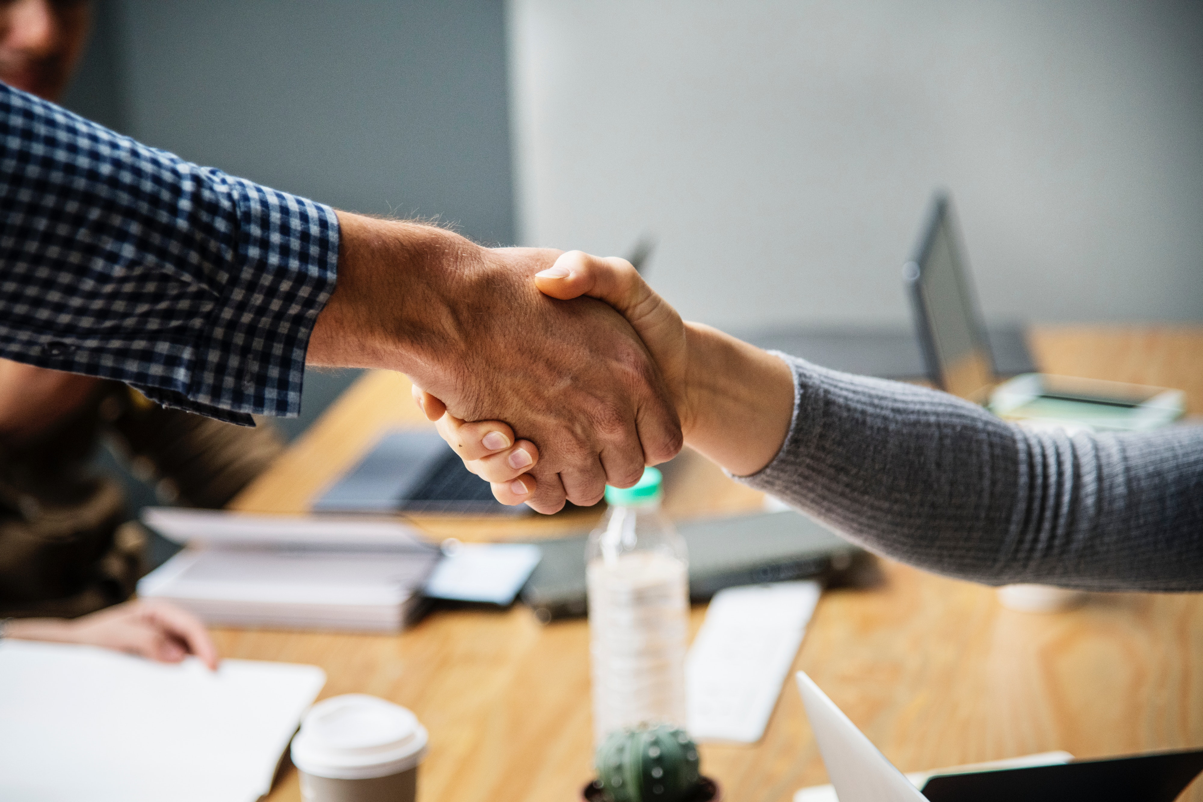 image of a man and woman shaking hands