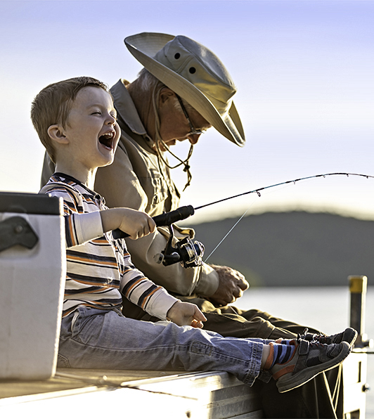 KWB Wealth | Redlands, CA: grandfather with grandson fishing