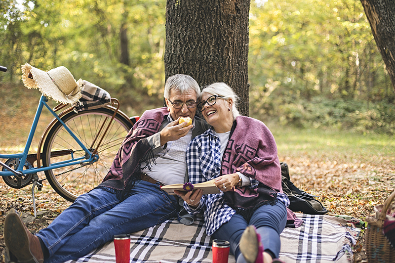 KWB Wealth | Redlands, CA: mature couple enjoying picnic under tree