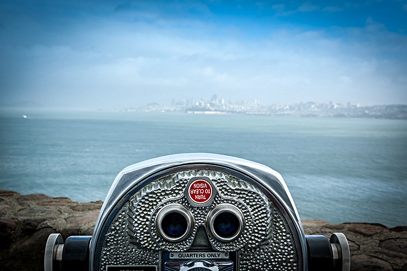KWB Wealth | Redlands, CA: binoculars looking across bay