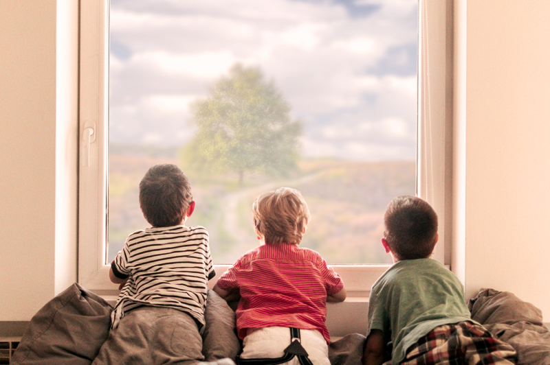 KWB Wealth | Redlands, CA: boys looking out window