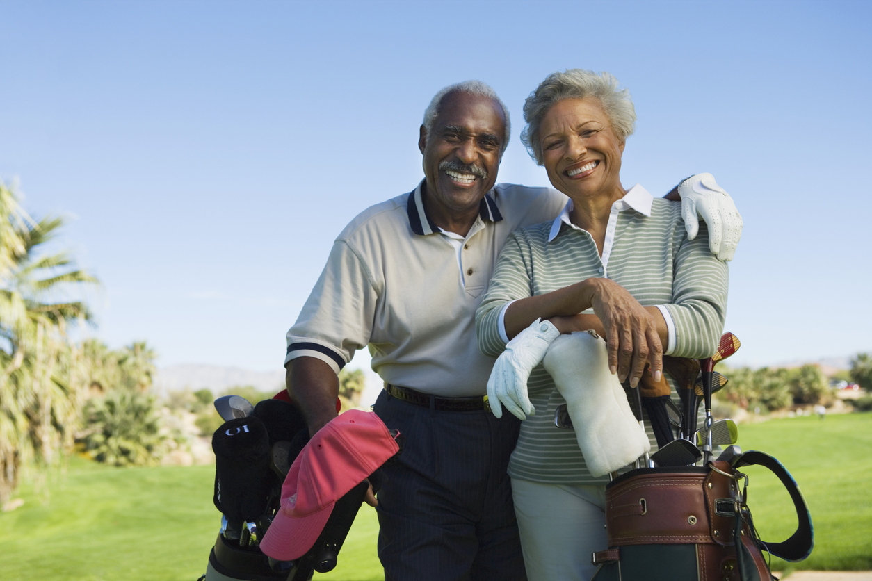 Cornerstone Wealth Advisory and Insurance in Erie, PA helps couples (as shown) plan for retirement enjoyment such as golf outings (as shown)