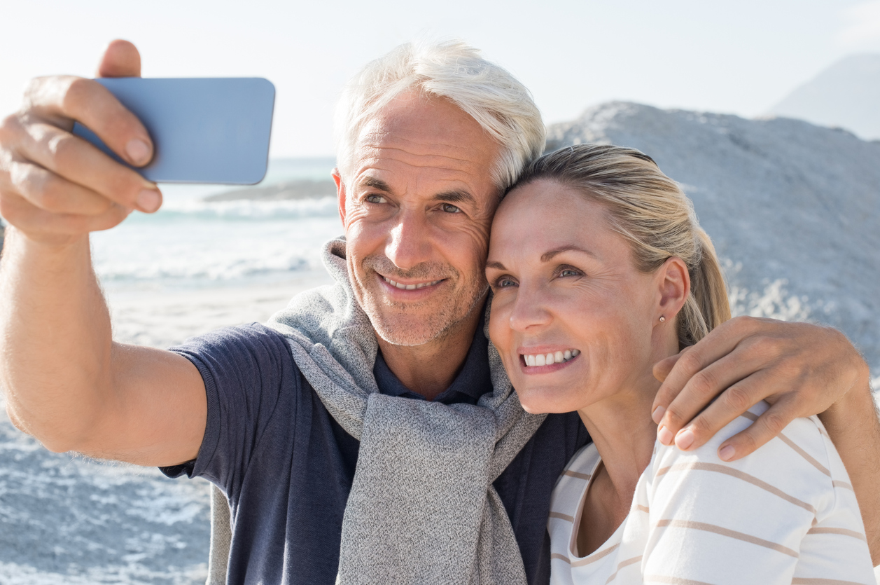 Couple enjoying retirement on vacation shown.