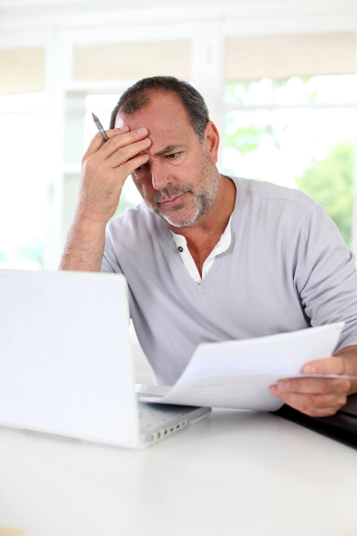 Man looking at tax paperwork