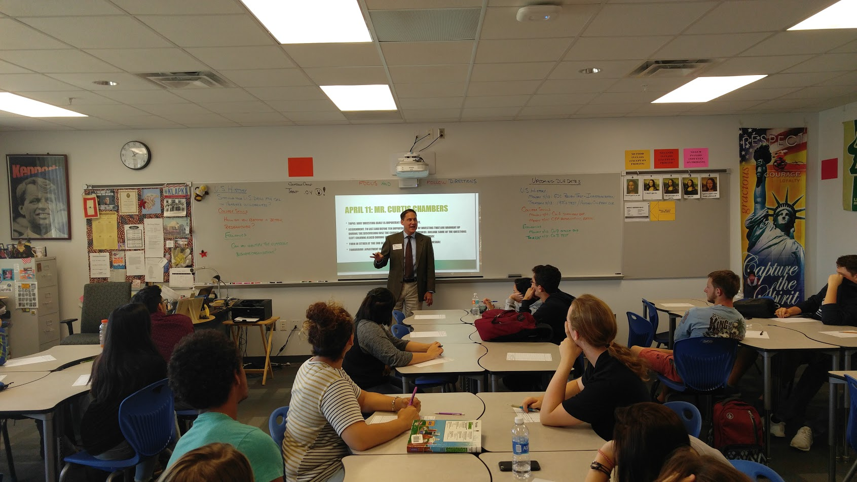 Curtis speaking to class at Largo High School