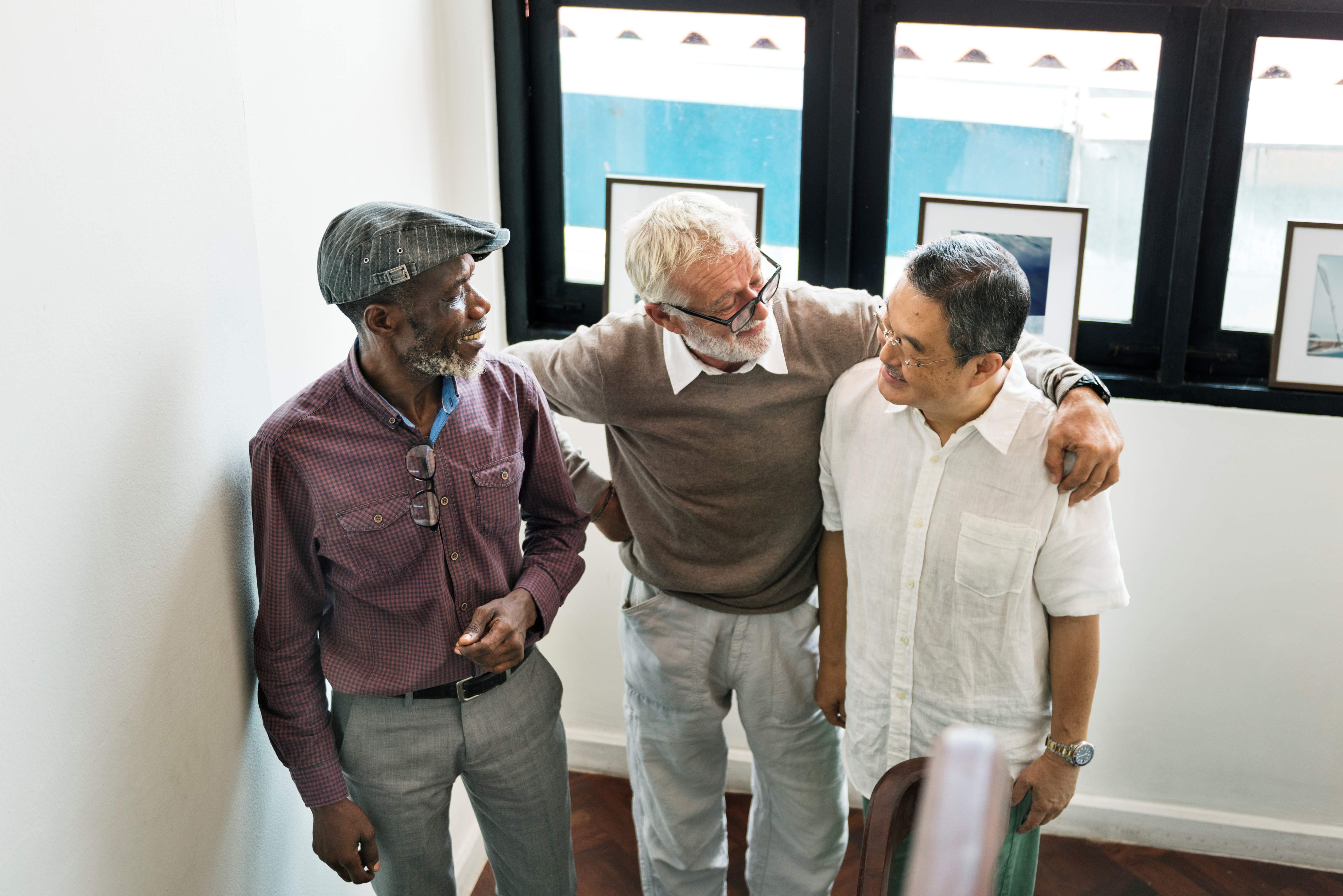 3 gentlemen conversating