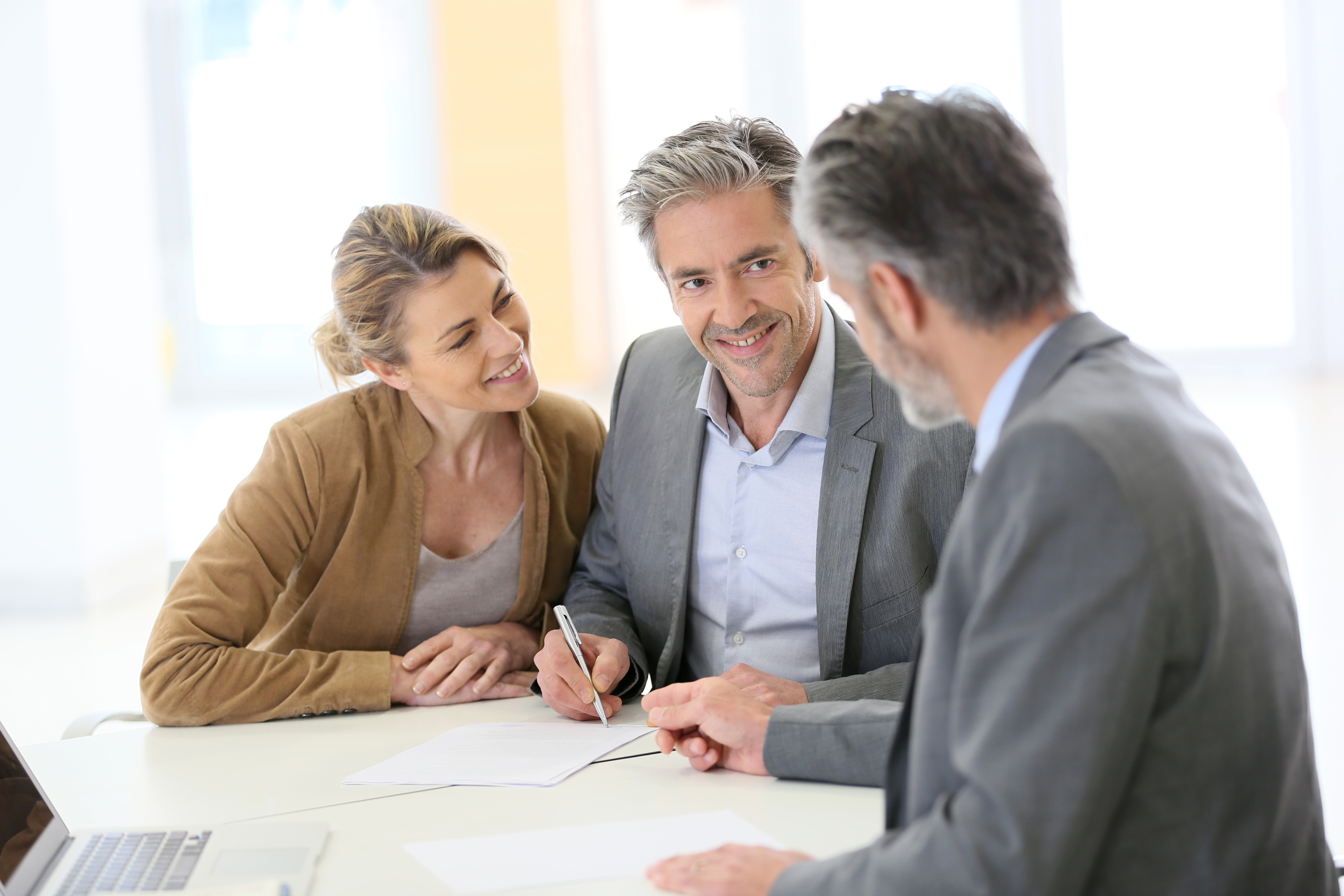 Financial Advisor helping clients in a planning meeting