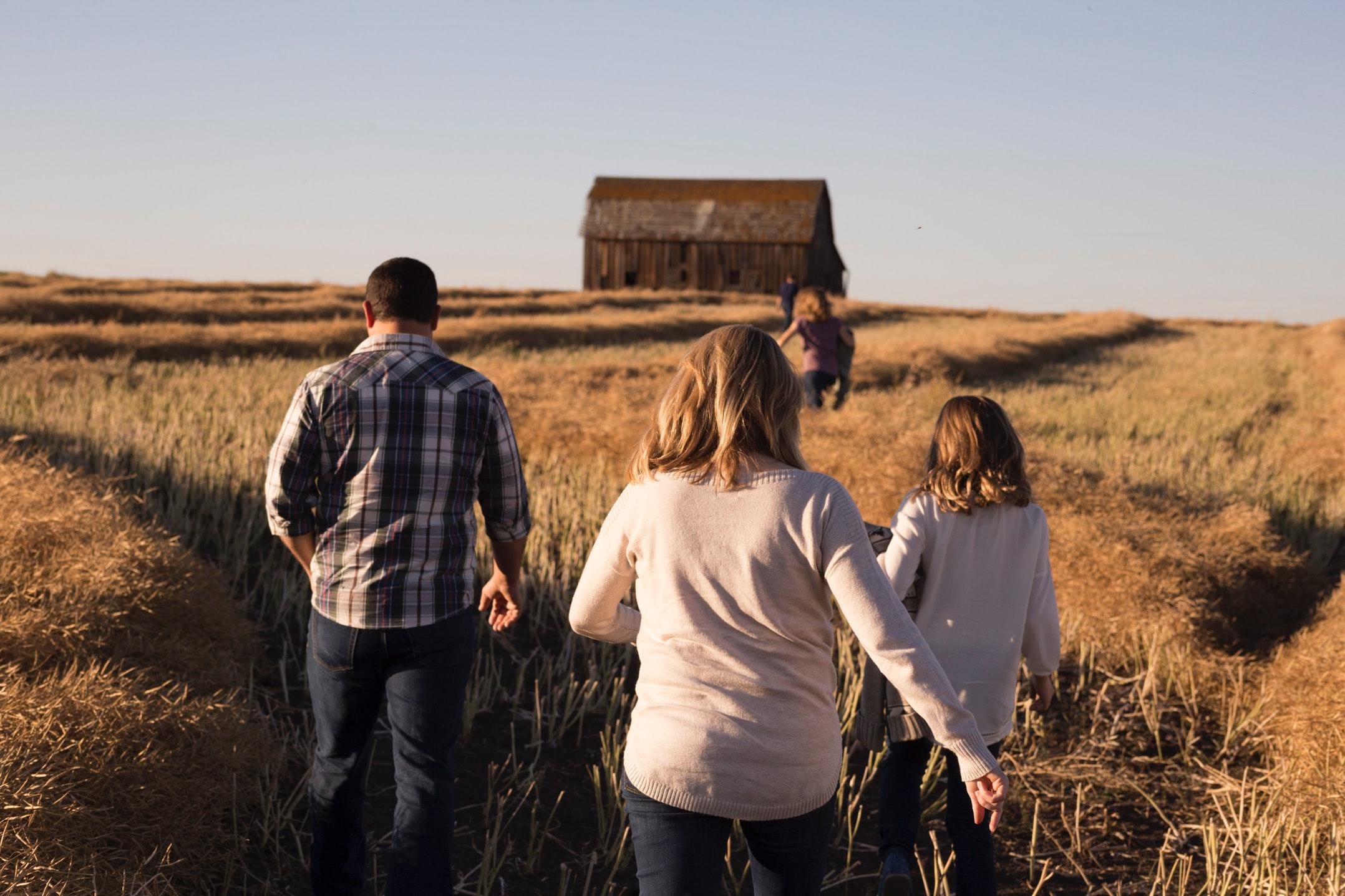 Family walking towards a barn