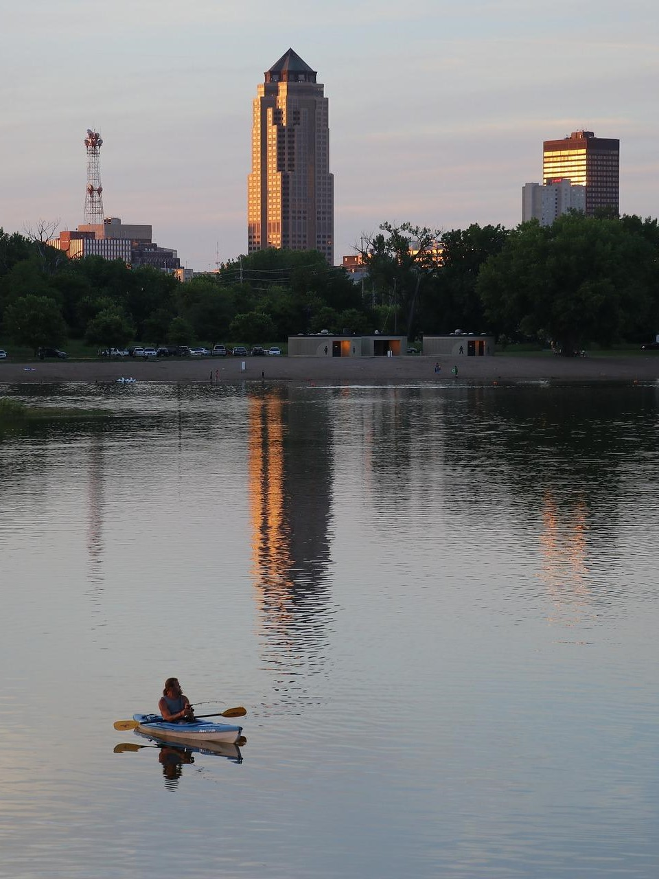 Man kayaking in river located in downtown Des Moines Iowa