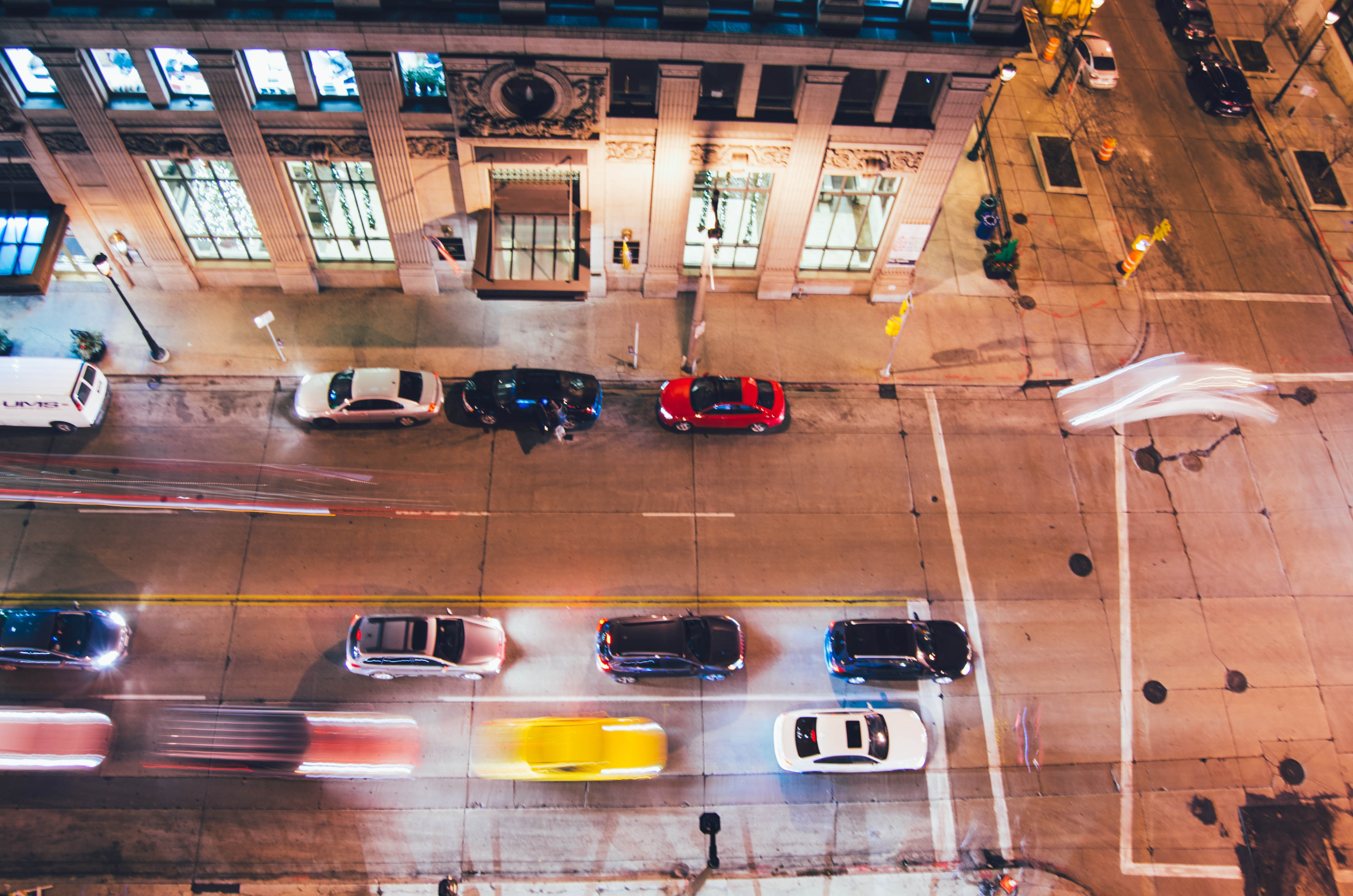 Street view of cars passing by
