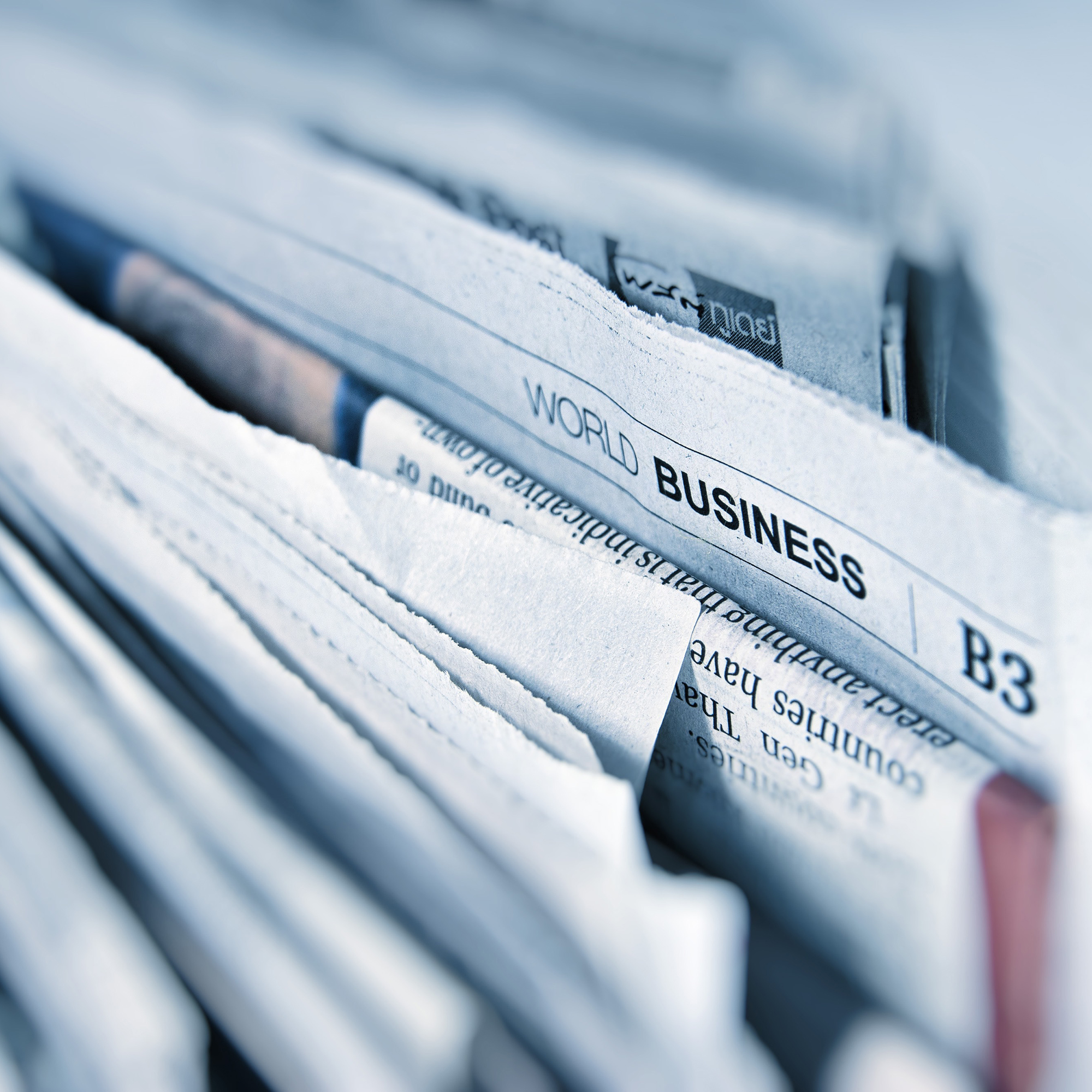 closeup photo of newspapers