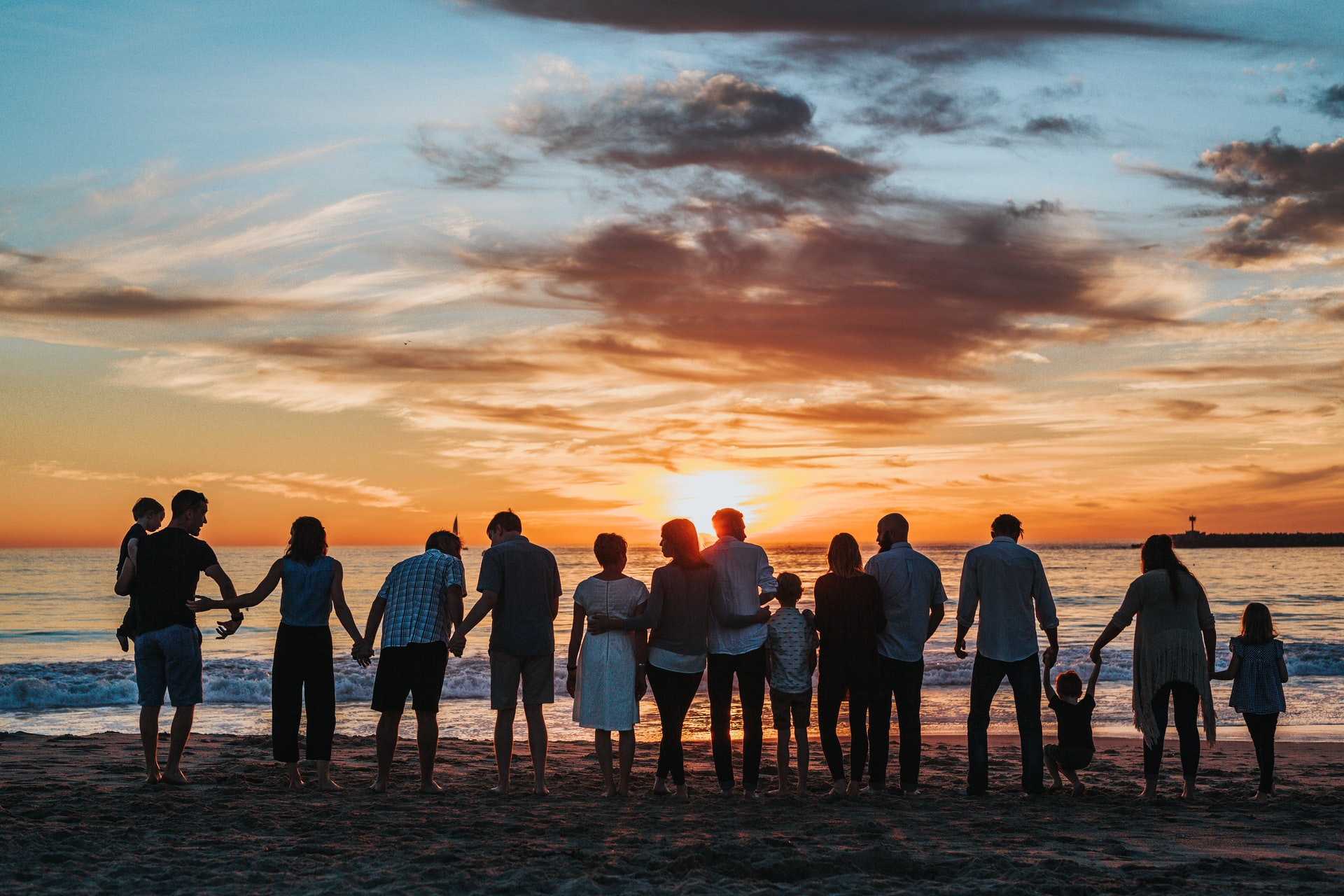 Group holding hands on beach