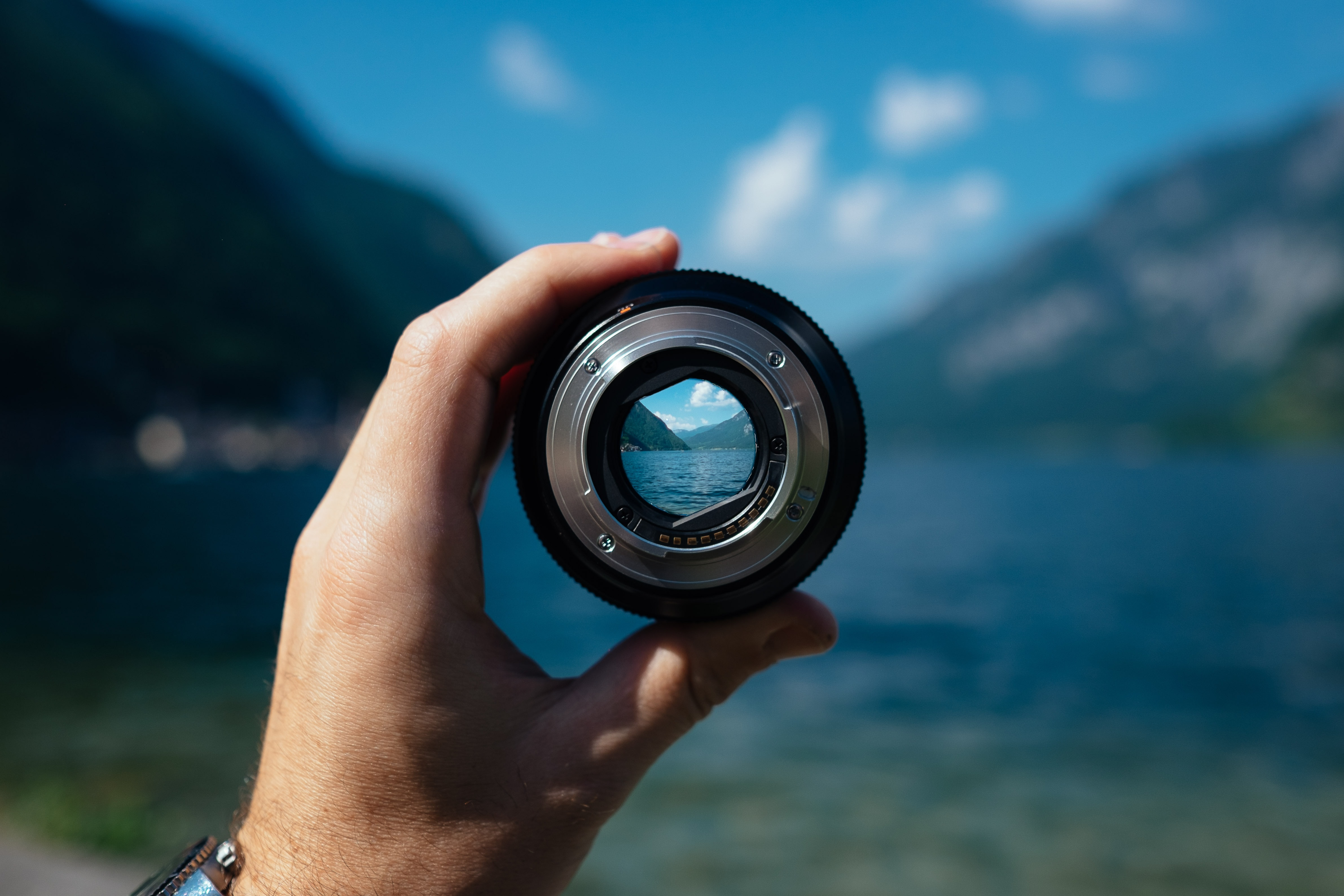 Camera lens focuses on a beautiful background, highlighting how Turning Point helps therapists in private practice see their future clearly.