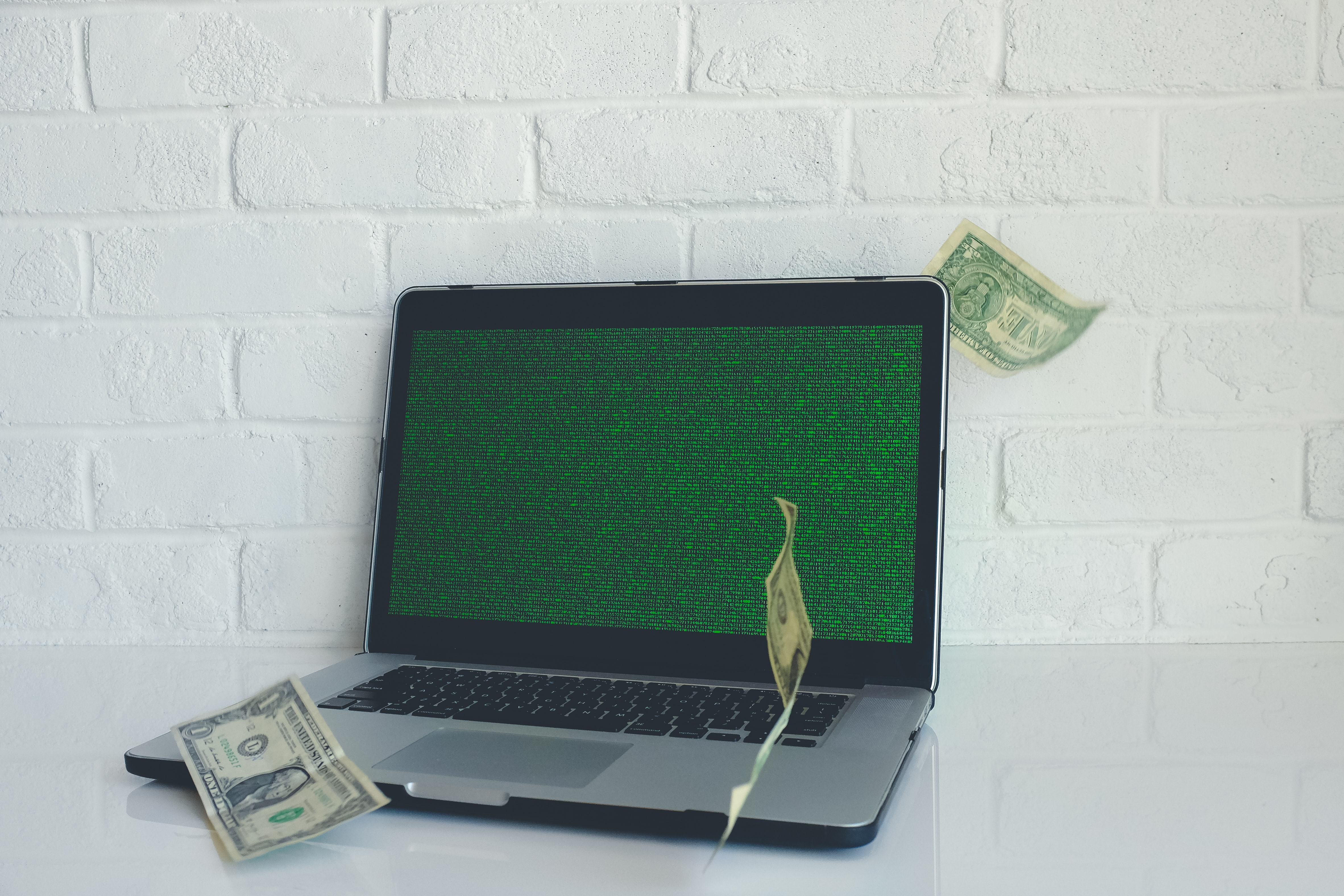 Money blows around a laptop, which is a pretty normal thing that happens.