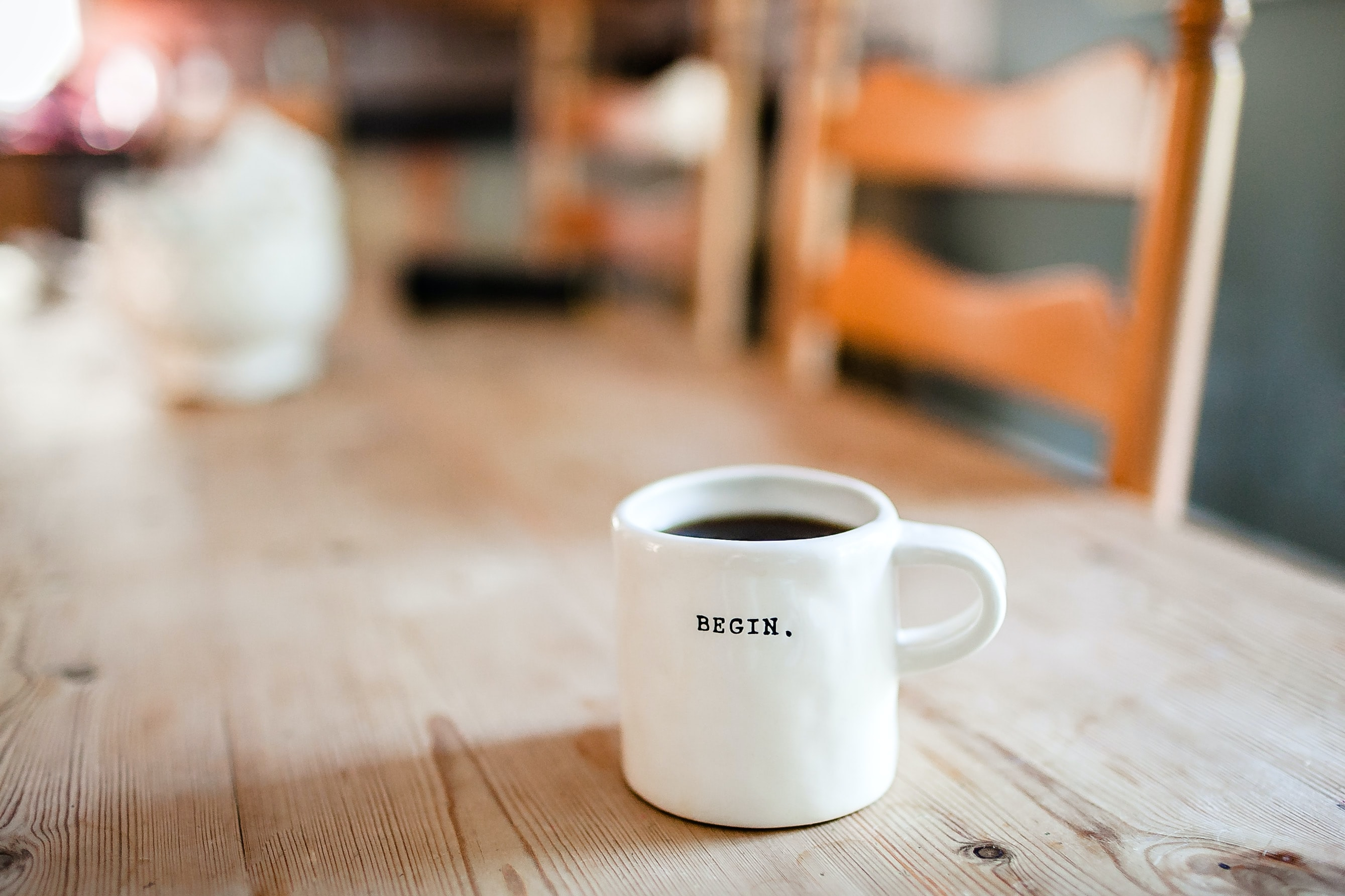 Fully coffee mug with BEGIN. inscribed. Because, like coffee, Life Planning is how we begin every financial planning engagement.