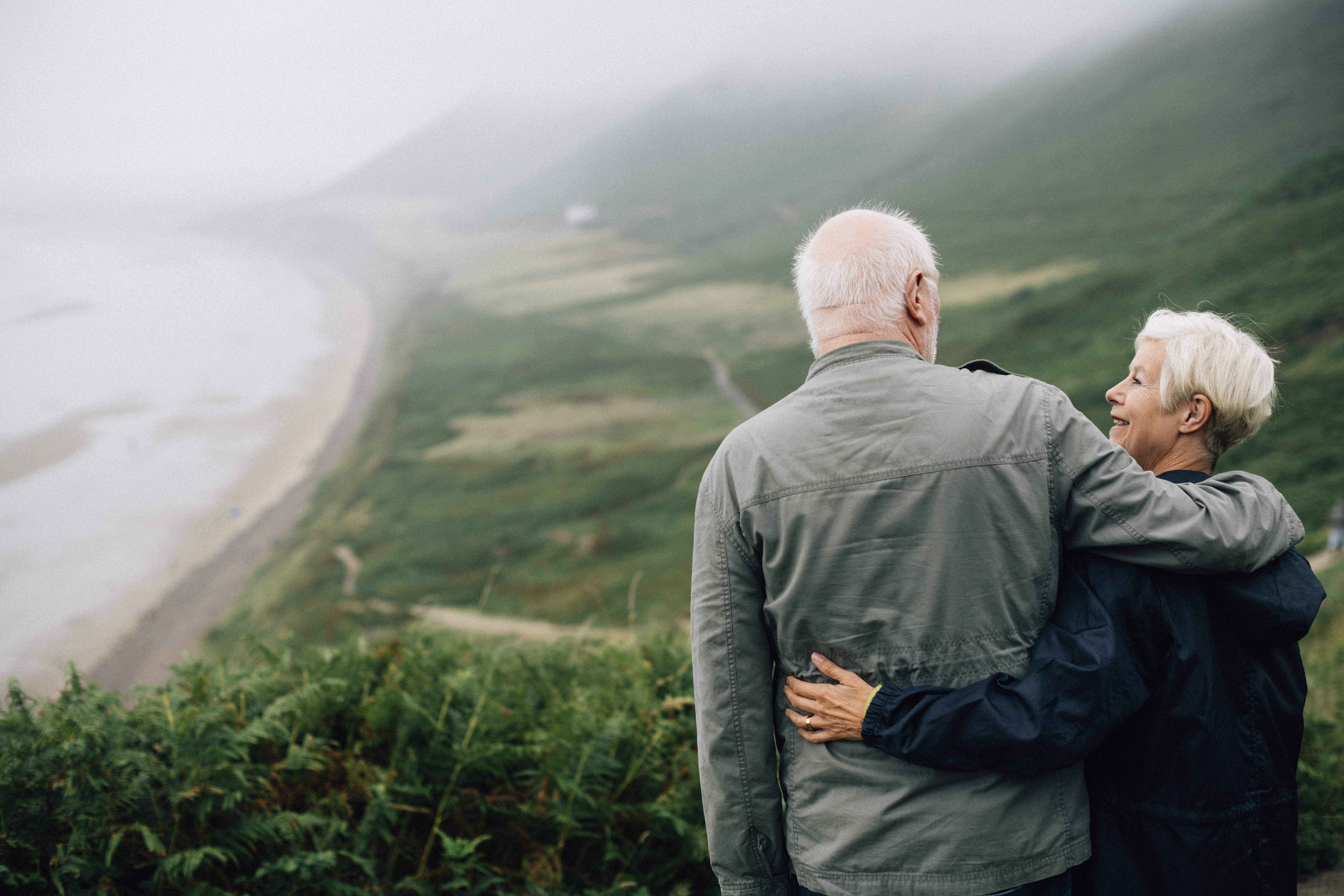 Retired couple overlooking valley