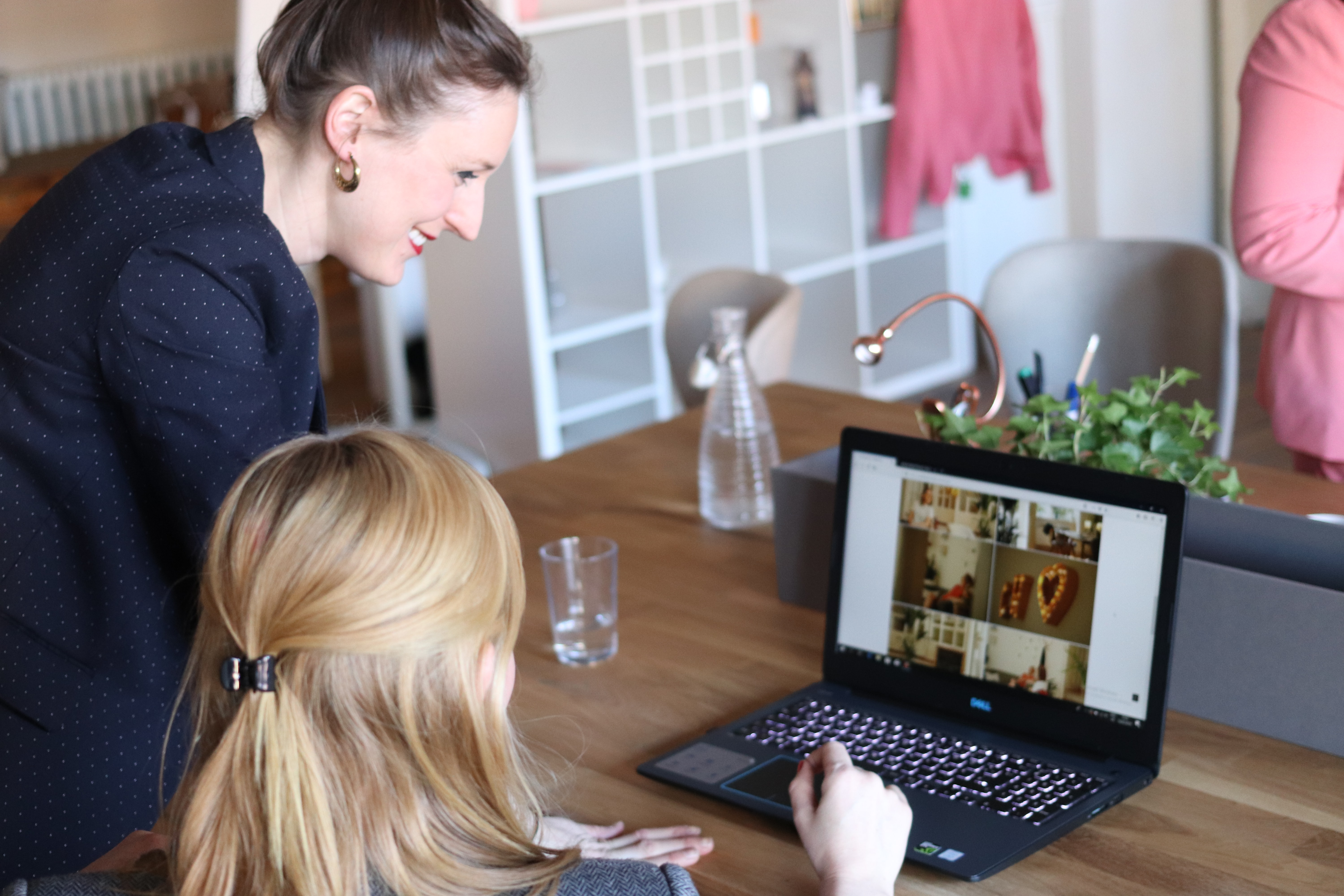 two women at a laptop