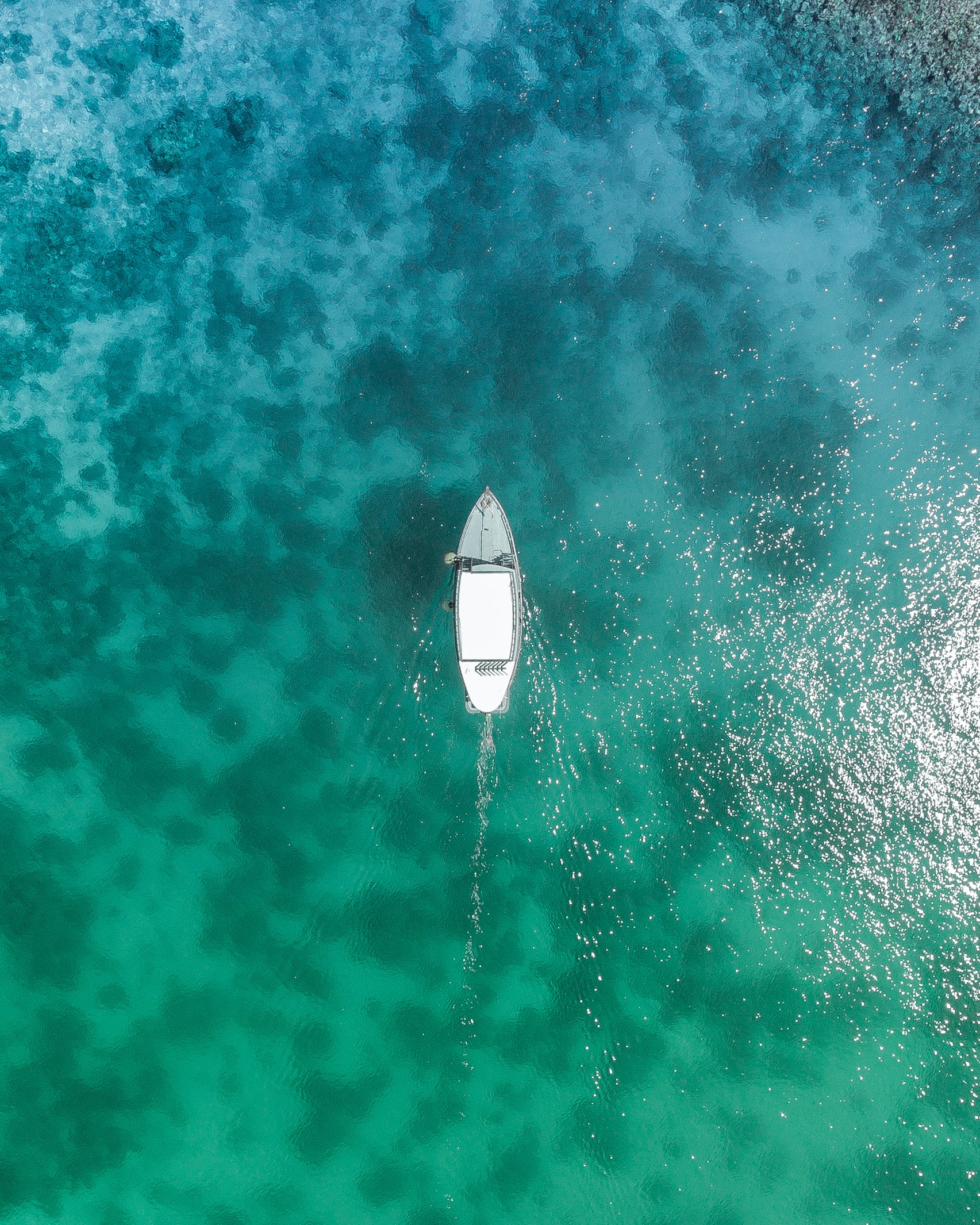Boat in the middle of the ocean.