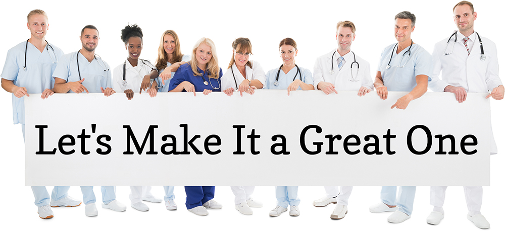 """Photo of many doctors and nurses holding a sign that says """"Let's Make It a Great One"""""""