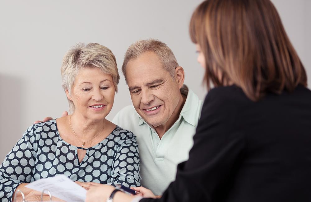 An elderly couple and a financial advisor