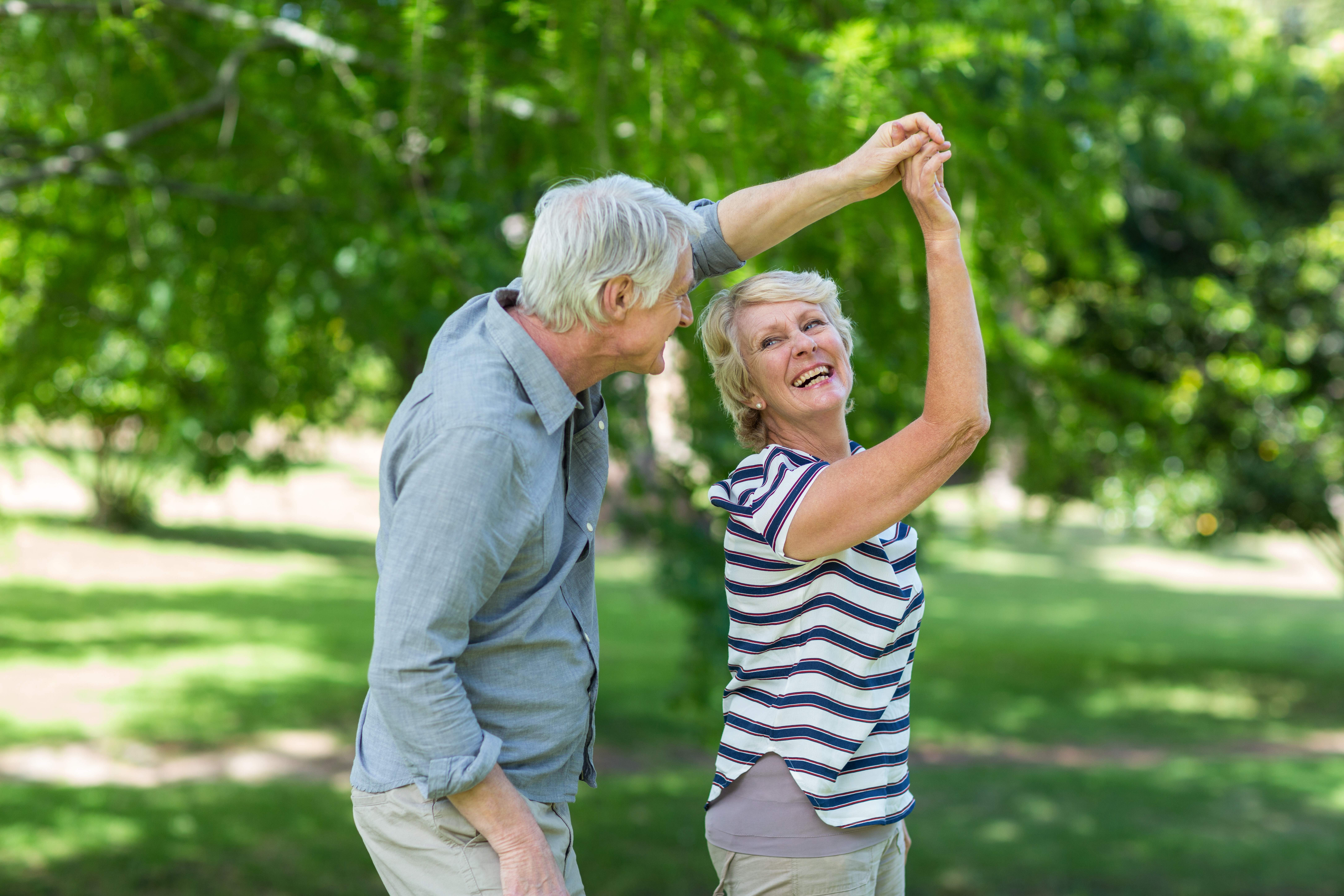 Senior couple smiling and dancing together