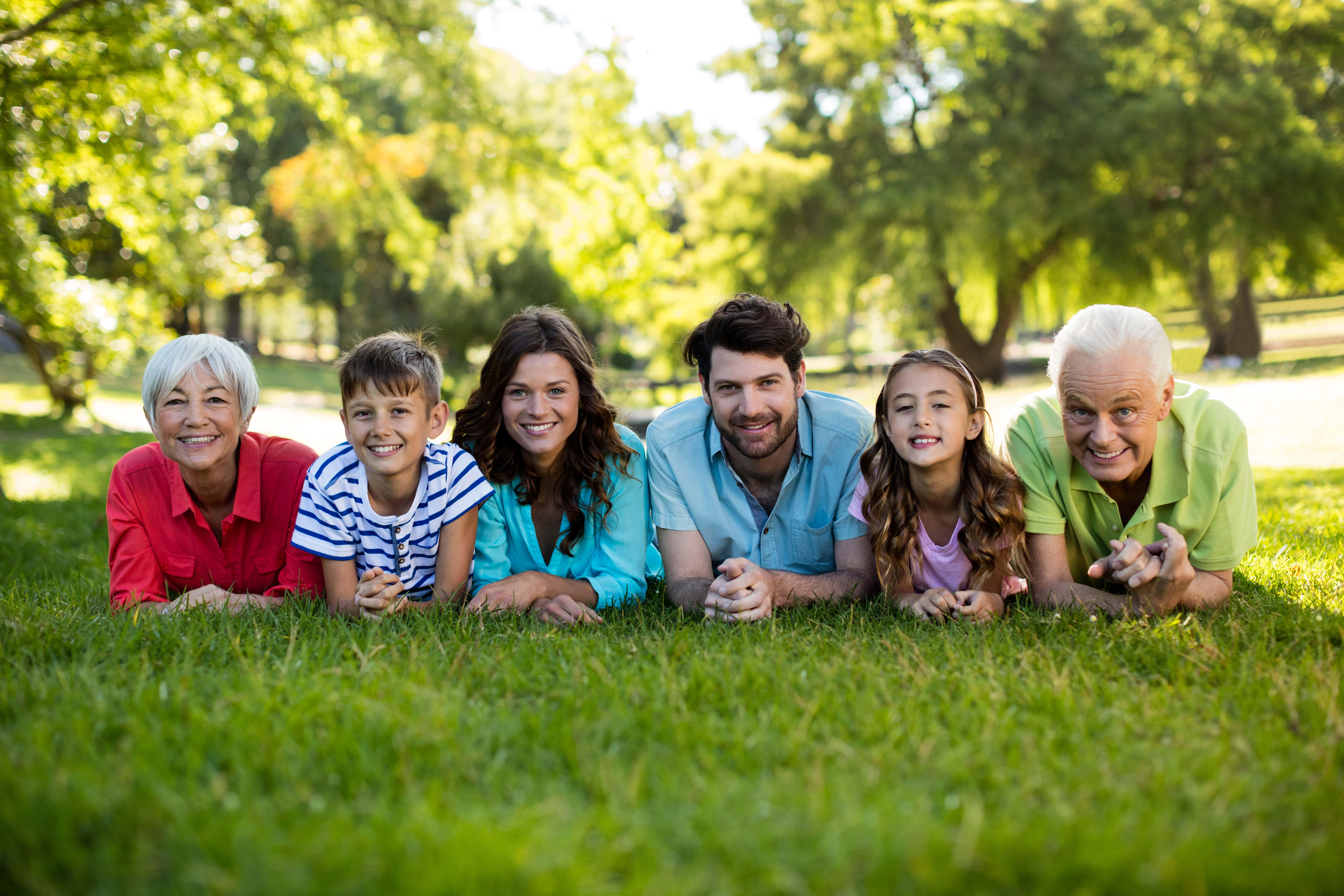 Family lying in a field