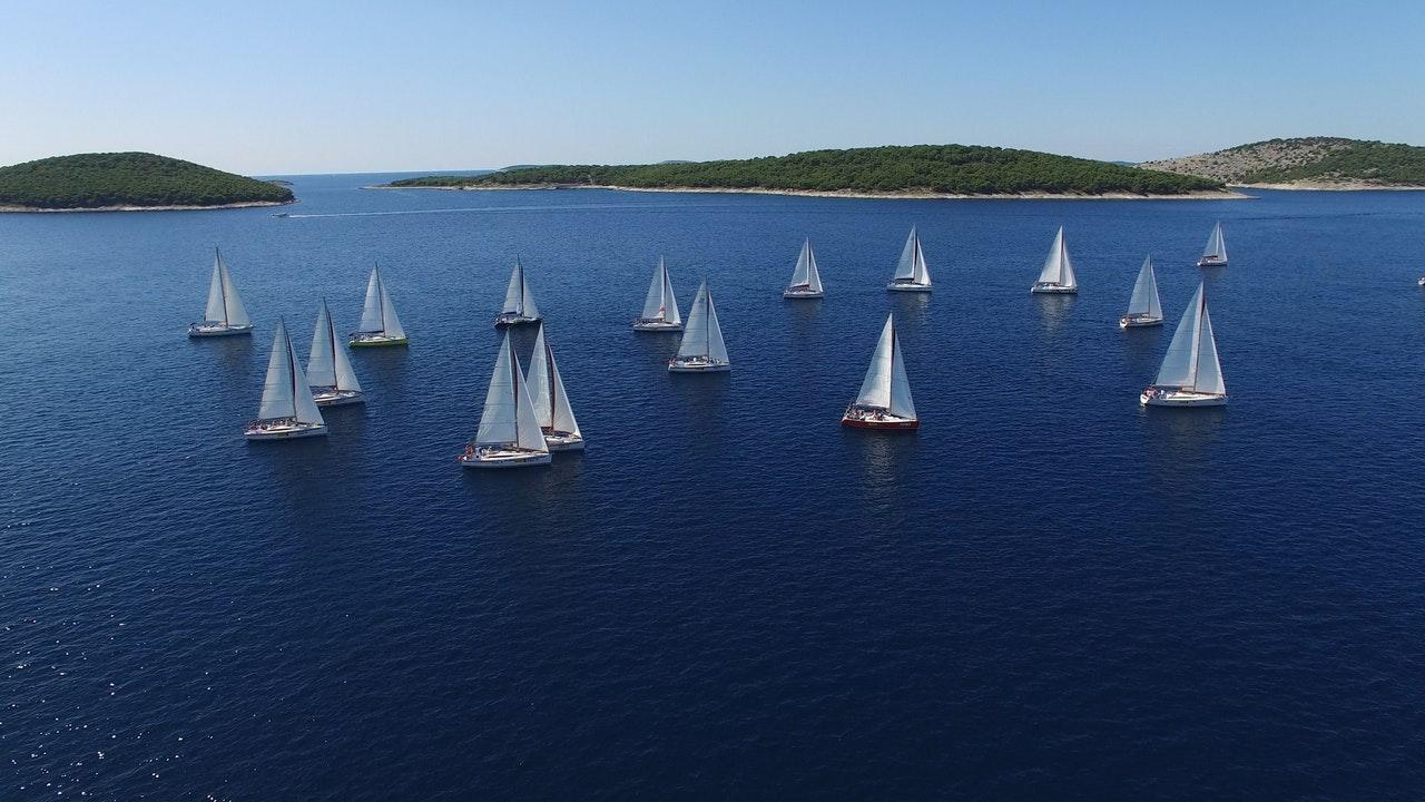 image of sailboats sitting on a still lake