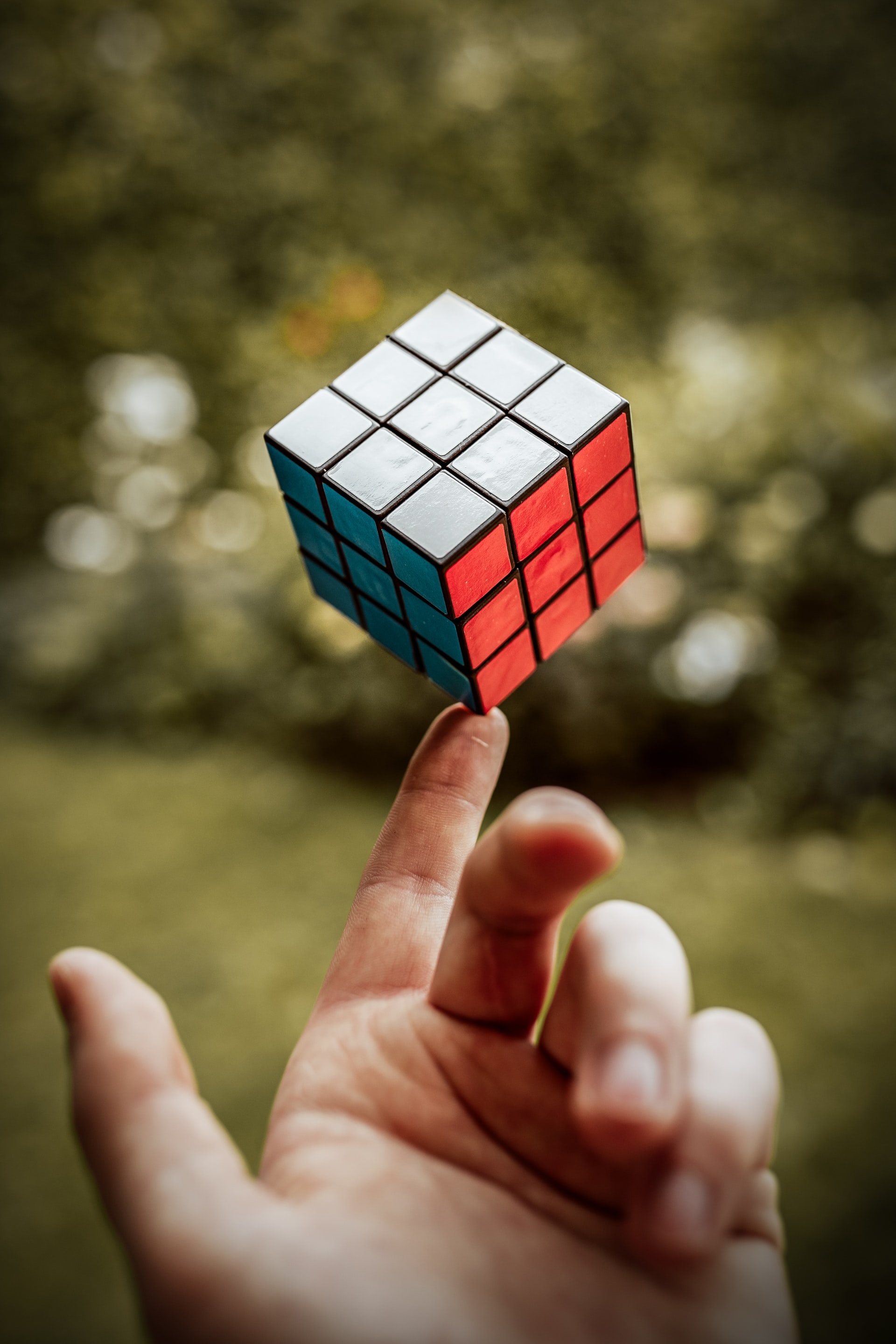 rubix cube balanced on finger