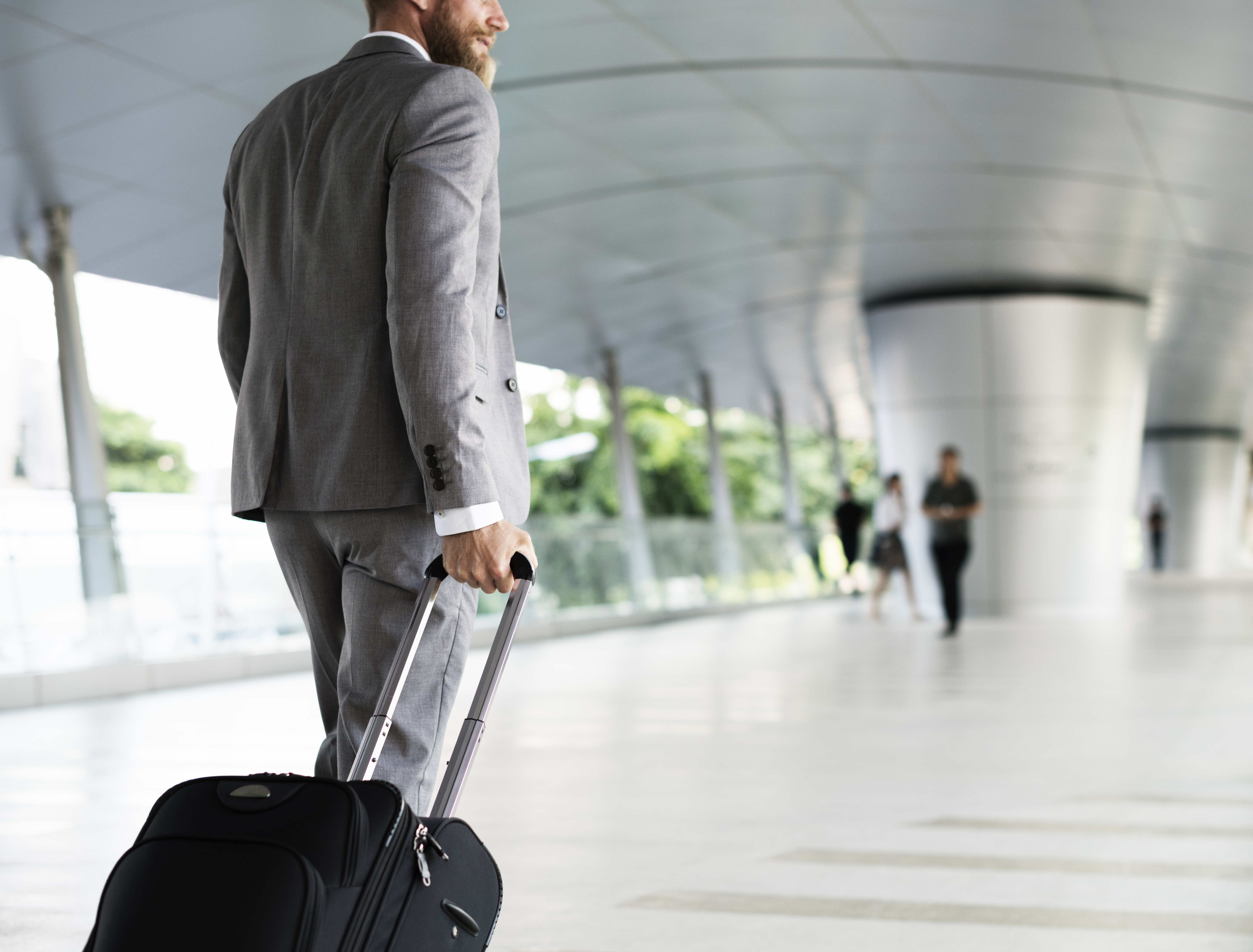 middle-aged businessman walking through airport