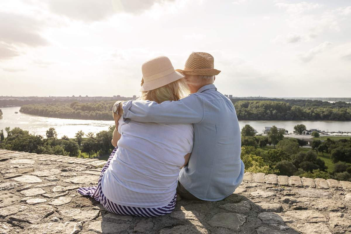 Older couple looking out at a river