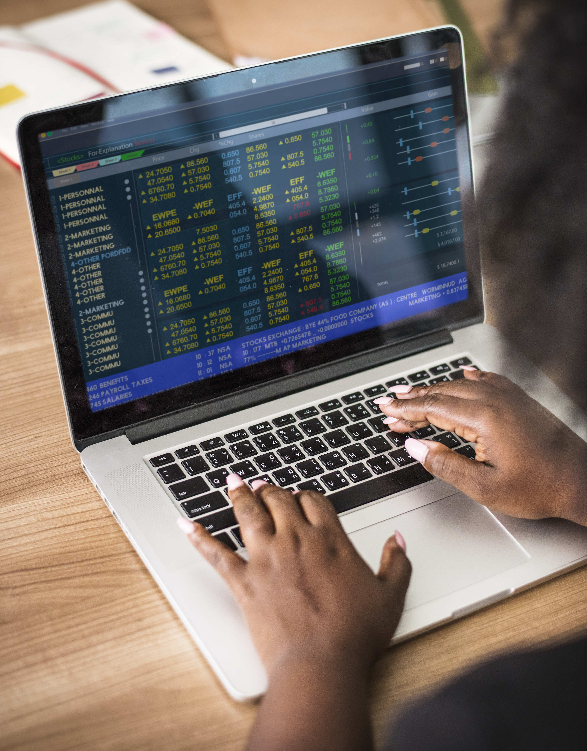 woman looking at stock ticker on laptop