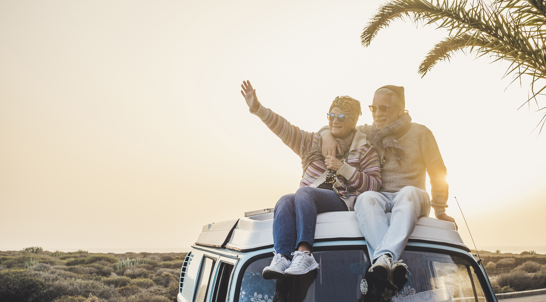 Elderly couple on top of camper