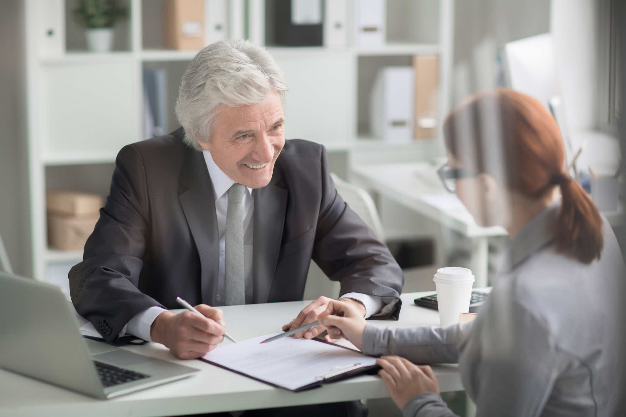 older businessman showing report to client