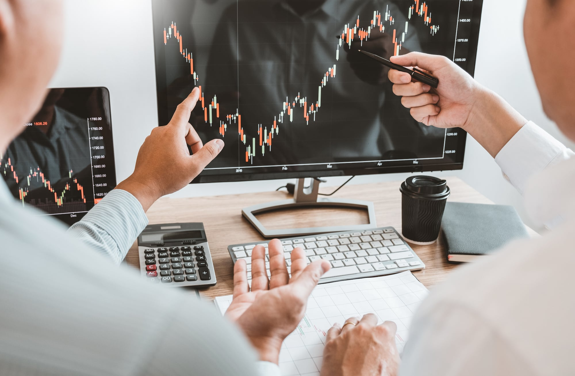 investor looking at stock charts on computer