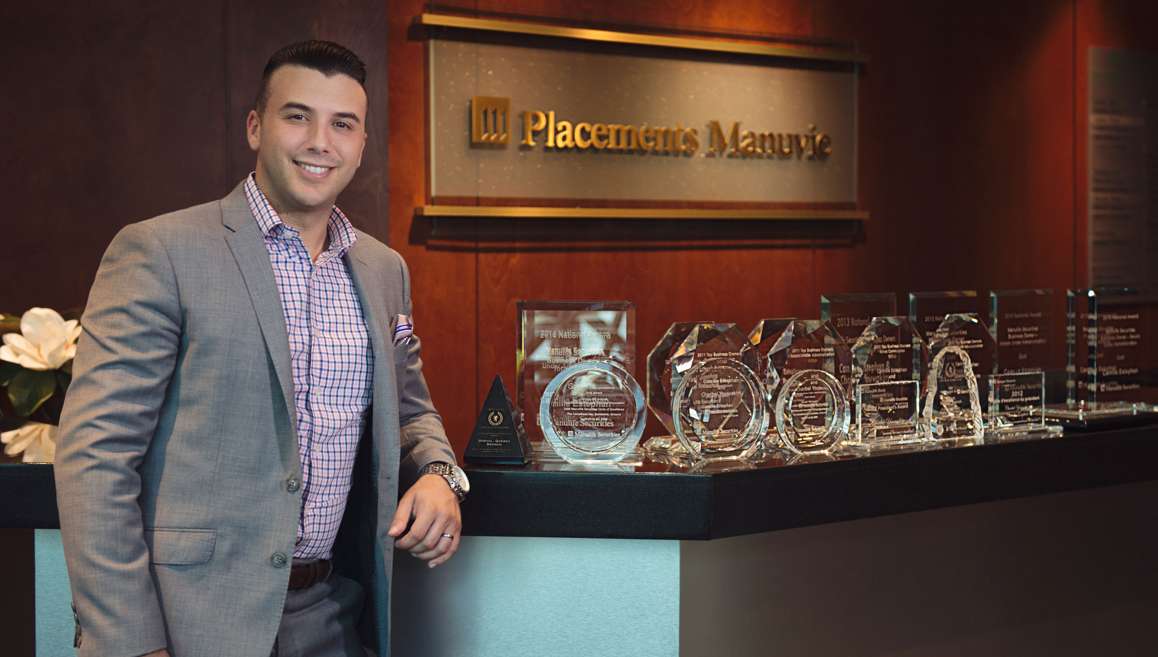 Corey Mancuso standing next to trophies