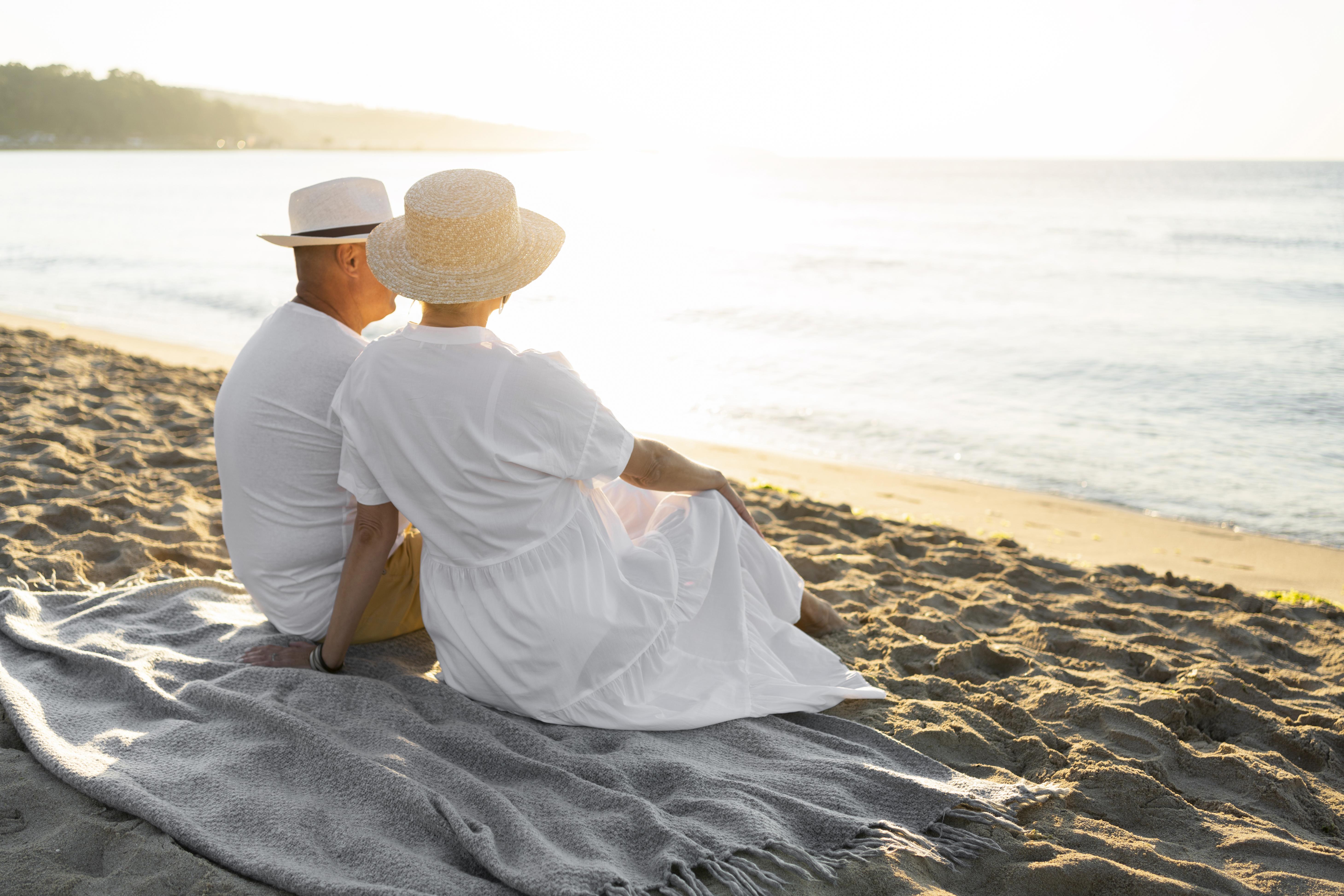 Couple sitting on the beach.